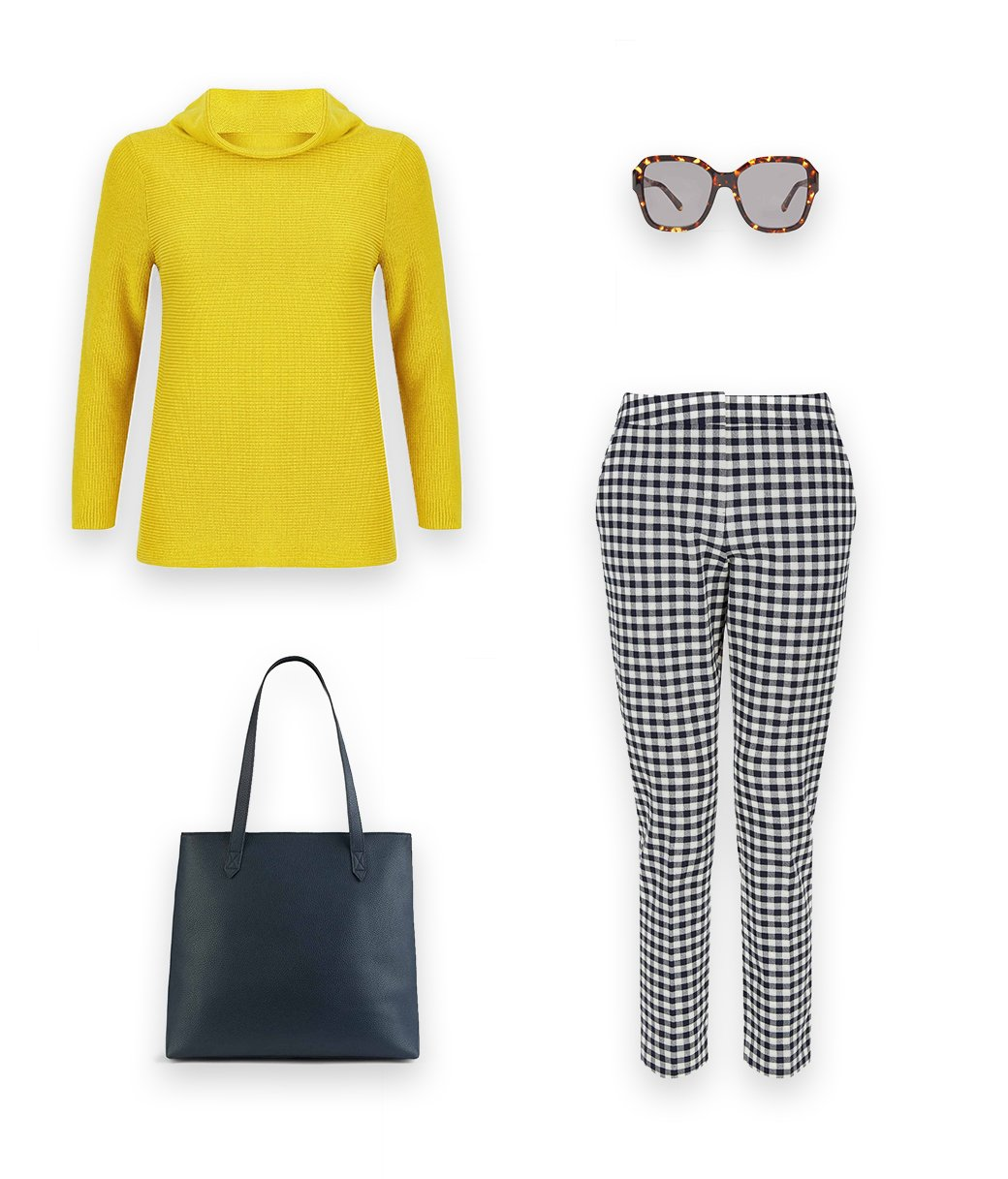 An effortless jumper outfit idea, style a yellow roll neck jumper with navy blue and white checked cropped trousers, sunglasses and a dark blue leather tote bag