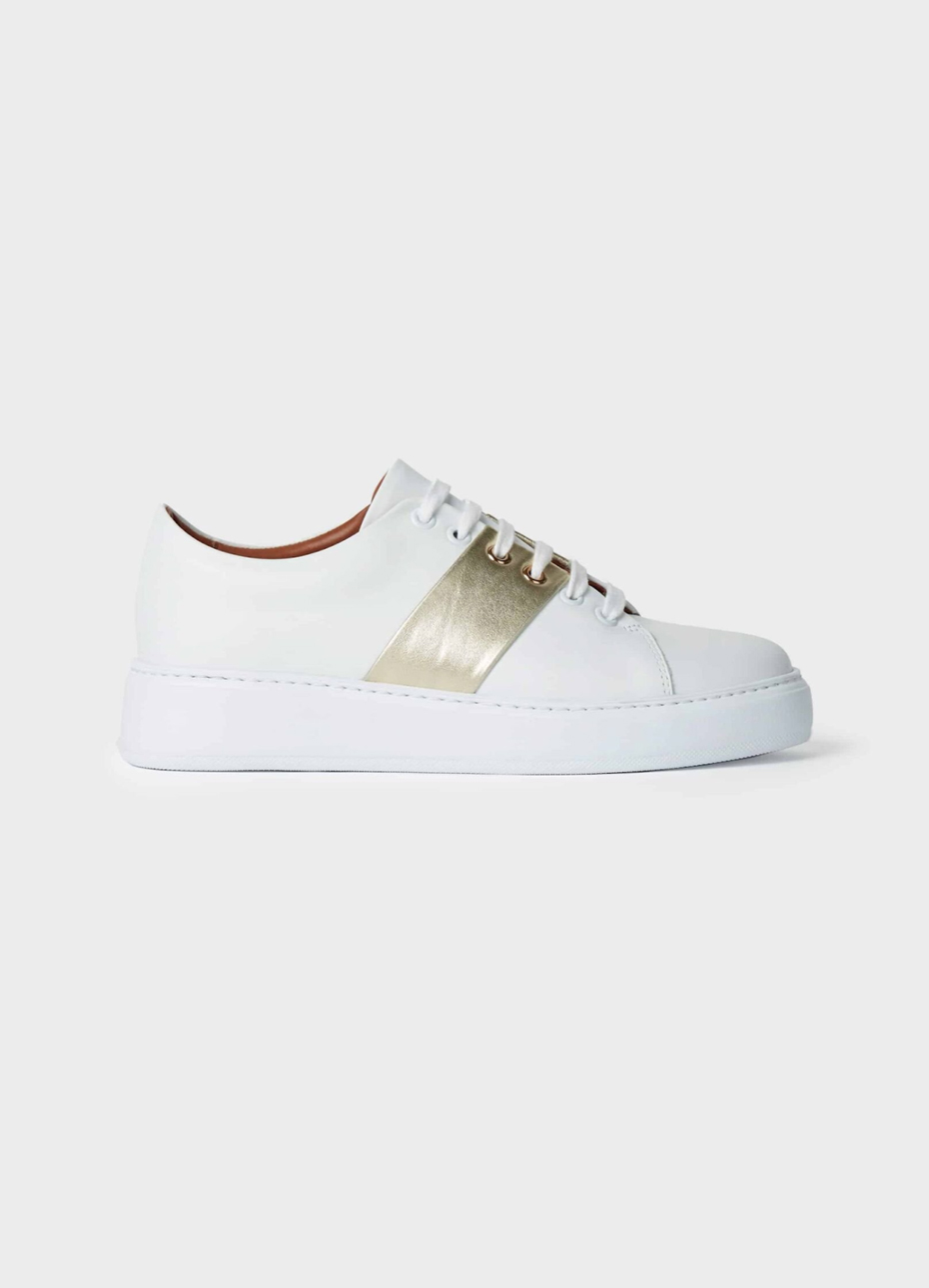 Hobbs leather trainer in white with a white sole and a gold metallic strip in the middle.