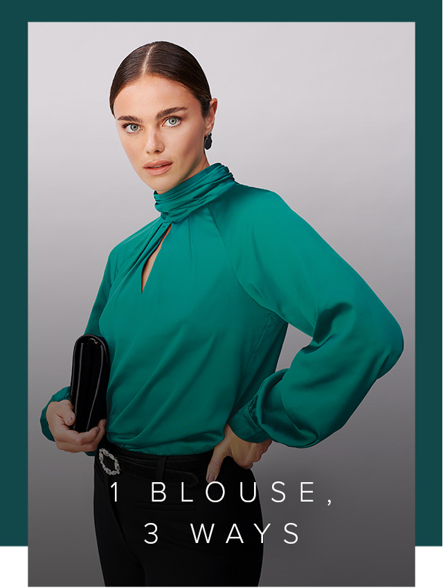 Model photographed wearing a green satin blouse with black trousers and a clutch bag.